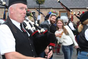 Dufftown pipers march down the street
