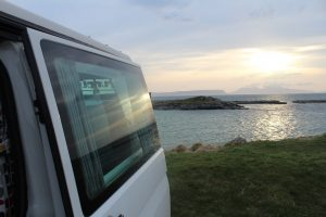 Camper van looking over the sunset